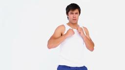 Man in sportswear kick boxing Footage