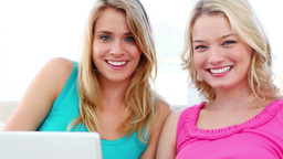 Happy women using a laptop Stock Video Footage
