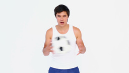 Man playing with a football Stock Video Footage