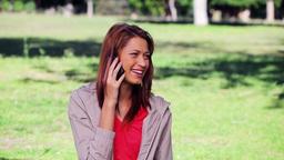 Brunette woman talking on a cellphone Footage