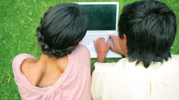 Happy couple using a laptop Footage