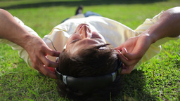 Peaceful man listening to music while lying on the Footage