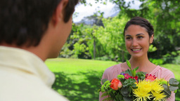Happy brunette woman holding a bunch of flowers Stock Video Footage