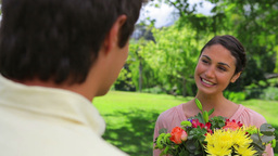 Happy brunette woman holding a bunch of flowers Footage
