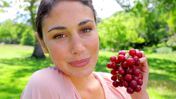 Smiling Woman Holding Grape Fruit stock footage