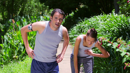 Happy couple running together Footage