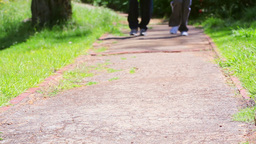 Two people running on a path Stock Video Footage