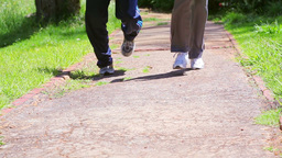 Two People Running On A Path stock footage