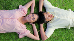 Peaceful couple napping together on the grass Stock Video Footage