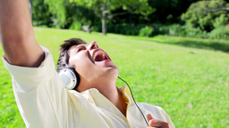Happy man listening to music while singing Footage
