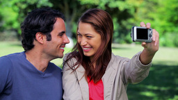 Happy couple taking a picture of themselves Stock Video Footage