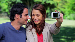 Happy couple taking a picture of themselves Footage