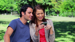 Smiling couple looking at a digital camera Stock Video Footage