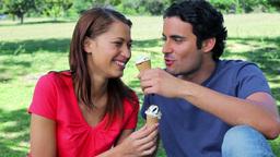 Joyful couple eating ice creams Footage