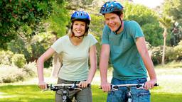 Couple on bikes Stock Video Footage