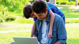 Father and son using a laptop Stock Video Footage