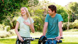 Laughing couple holding bikes Footage
