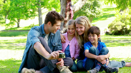 Family watching picture on a digital camera Stock Video Footage