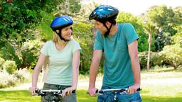 Couple biking with bicycle helmet Stock Video Footage