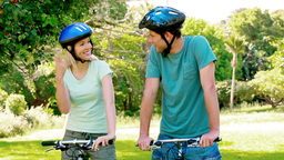 Couple biking with bicycle helmet Stock Video Footage