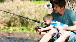 Man fishing with his little boy Footage