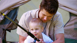 Little boy fishing with his father Footage