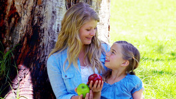 Mother and daughter holding apples Footage
