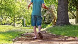 Man walking with his son on shoulders Stock Video Footage