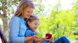 Daughter and mother holding apples Footage
