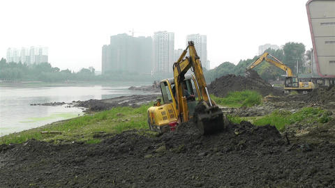 Riverbank Construction Sichuan China 5 machine Stock Video Footage