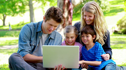 Parents and children using a laptop Stock Video Footage