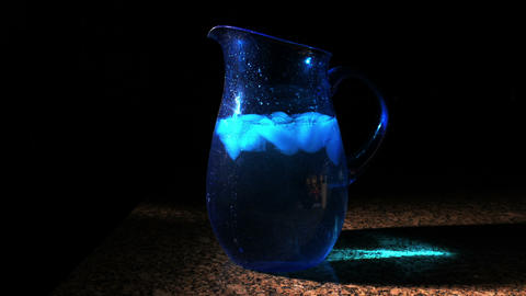 1716 Blue Pitcher with Ice Falling into Water, HD Footage