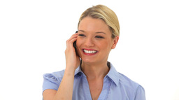 Smiling blonde woman talking on the phone Footage