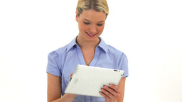 Blonde woman using a tablet pc Footage