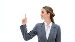 Smiling woman pointing her finger up Stock Video Footage