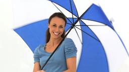Smiling brunette holding her umbrella Footage