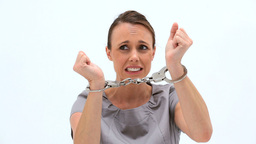 Serious woman wearing handcuffs Footage