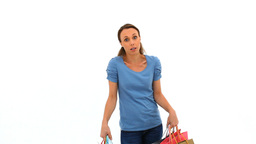 Tired woman holding shopping bags Stock Video Footage