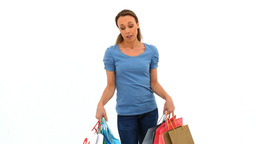 Tired woman holding shopping bags Footage