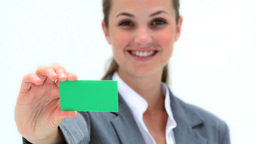 Smiling woman holding a business card Footage