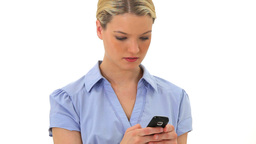Serious blonde woman sending a text Footage