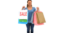 Smiling brunette holding shopping bags Footage