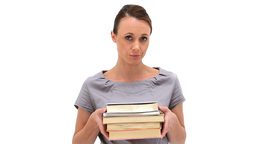 Brunette woman holding books Stock Video Footage