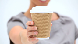 Woman holding a cup of coffee Footage