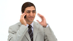 Smiling man talking on his mobile phone Stock Video Footage