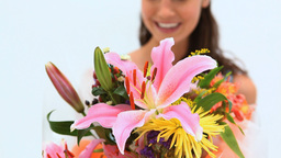 Happy brunette holding a bunch of flowers Stock Video Footage