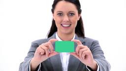 Happy brunette holding a business card Footage