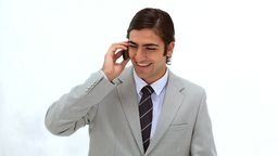 Smiling man using his mobile phone Footage