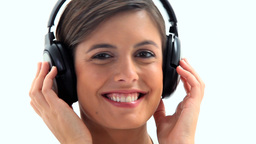 Smiling brunette wearing headphones Footage
