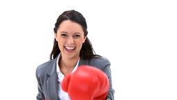 Businesswoman boxing with red gloves Footage